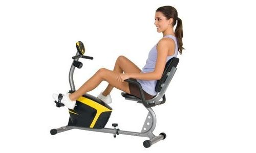 A young woman using the best recumbent exercise bike